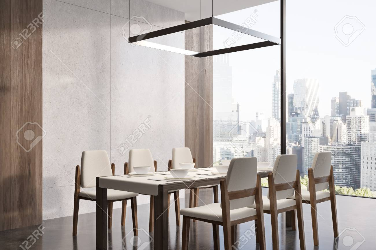 Corner Of A Dining Room Interior With Concrete Walls Wooden Stock Photo Picture And Royalty Free Image Image 79423560