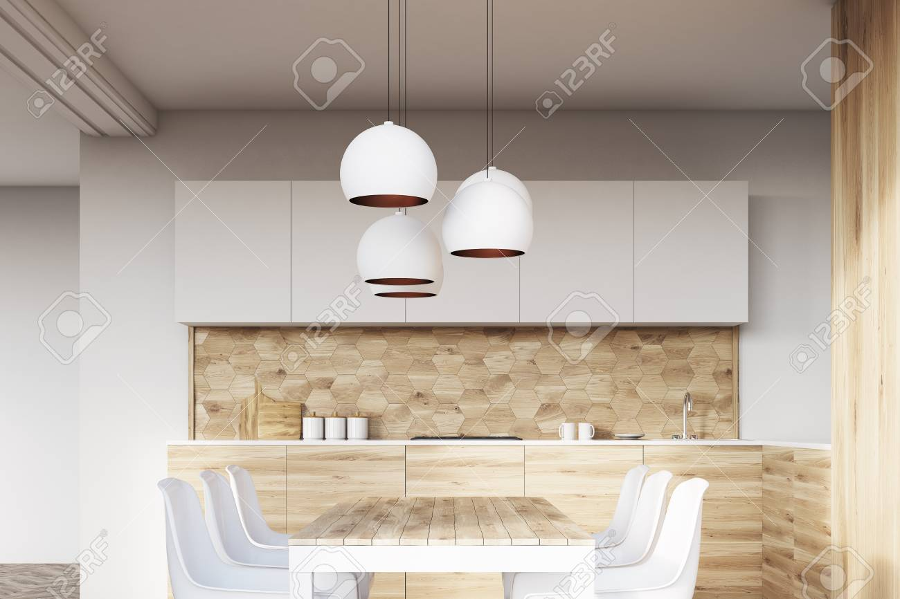 View Of A Light Wooden Kitchen Interior With White Walls And