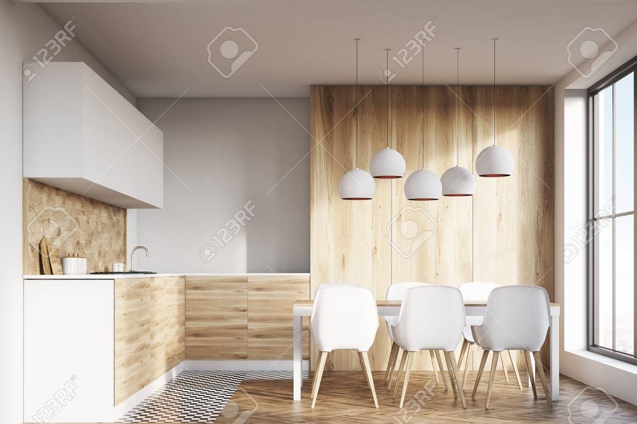 Light wooden kitchen interior with white walls and wooden floor...