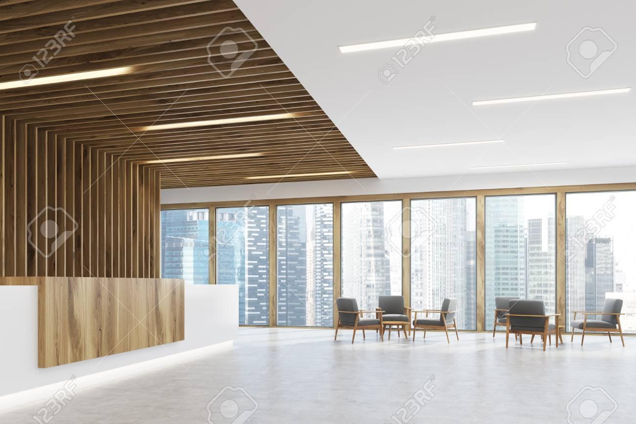 Ufficio Bianco E Legno : Vista laterale di un bancone reception in legno bianco e ligth è