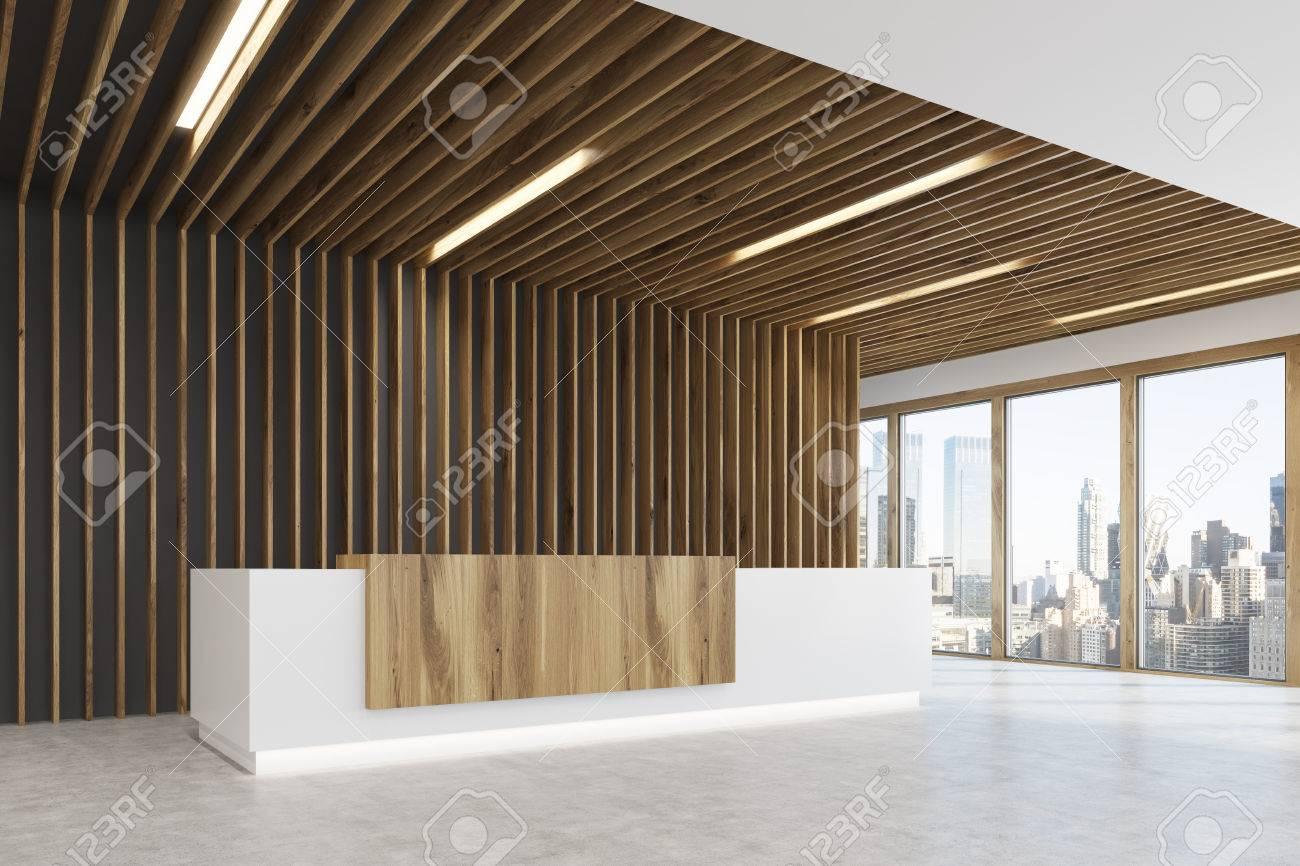 La vue latérale d un comptoir de réception blanc et en bois clair