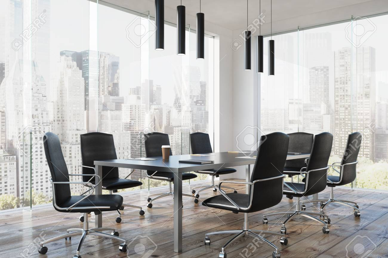 Corner of a modern meeting room interior with a long table, black..