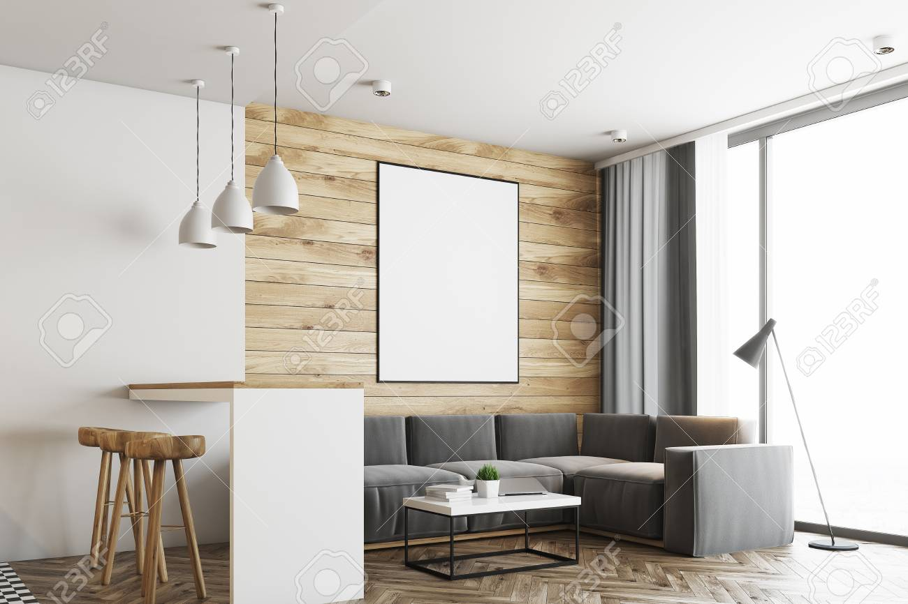 Living room in a studio apartment with wooden and white walls,..