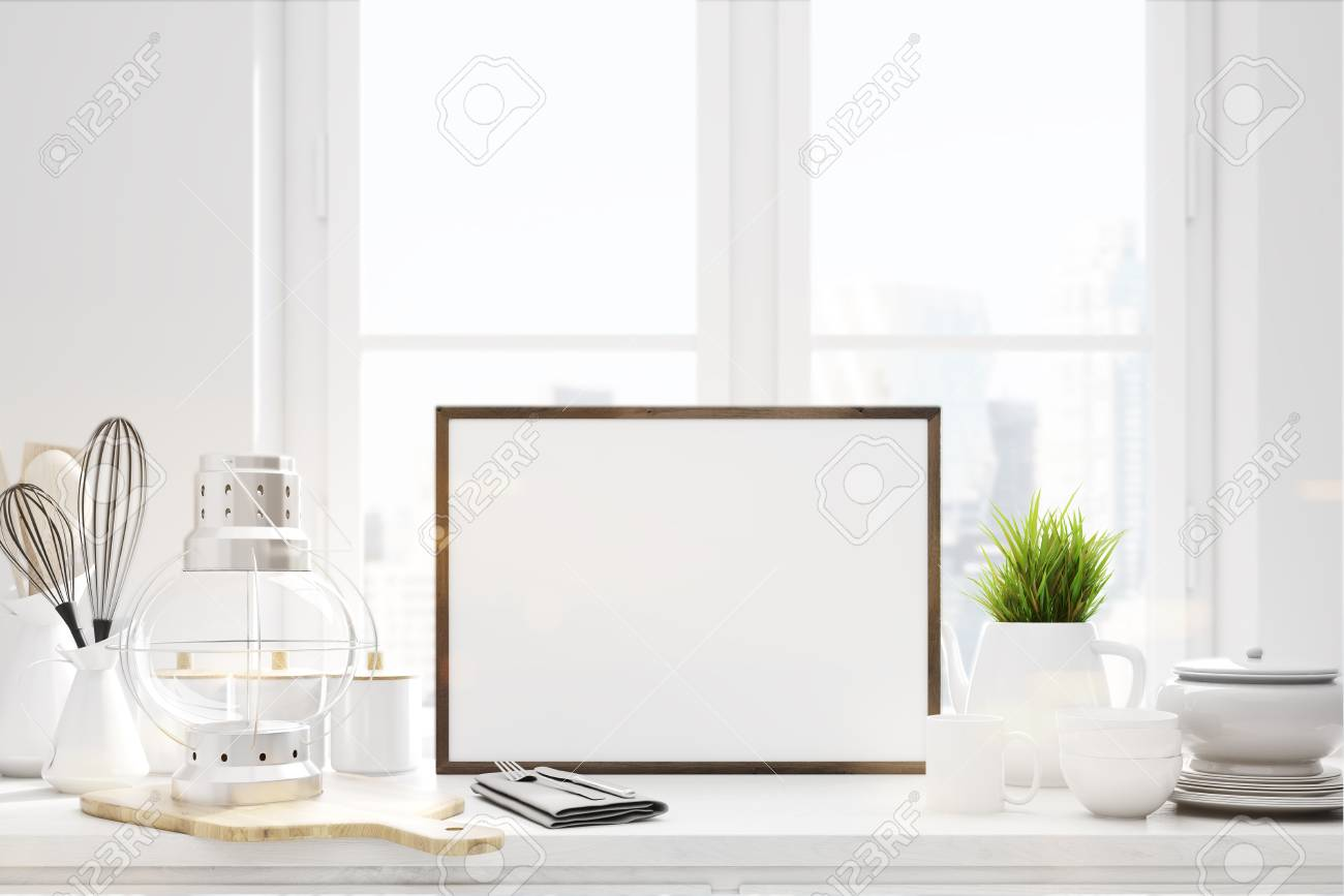 kitchen counter close up. Close Up Of A White Kitchen Counter With Cutting Board, Kitchenware And Picture E