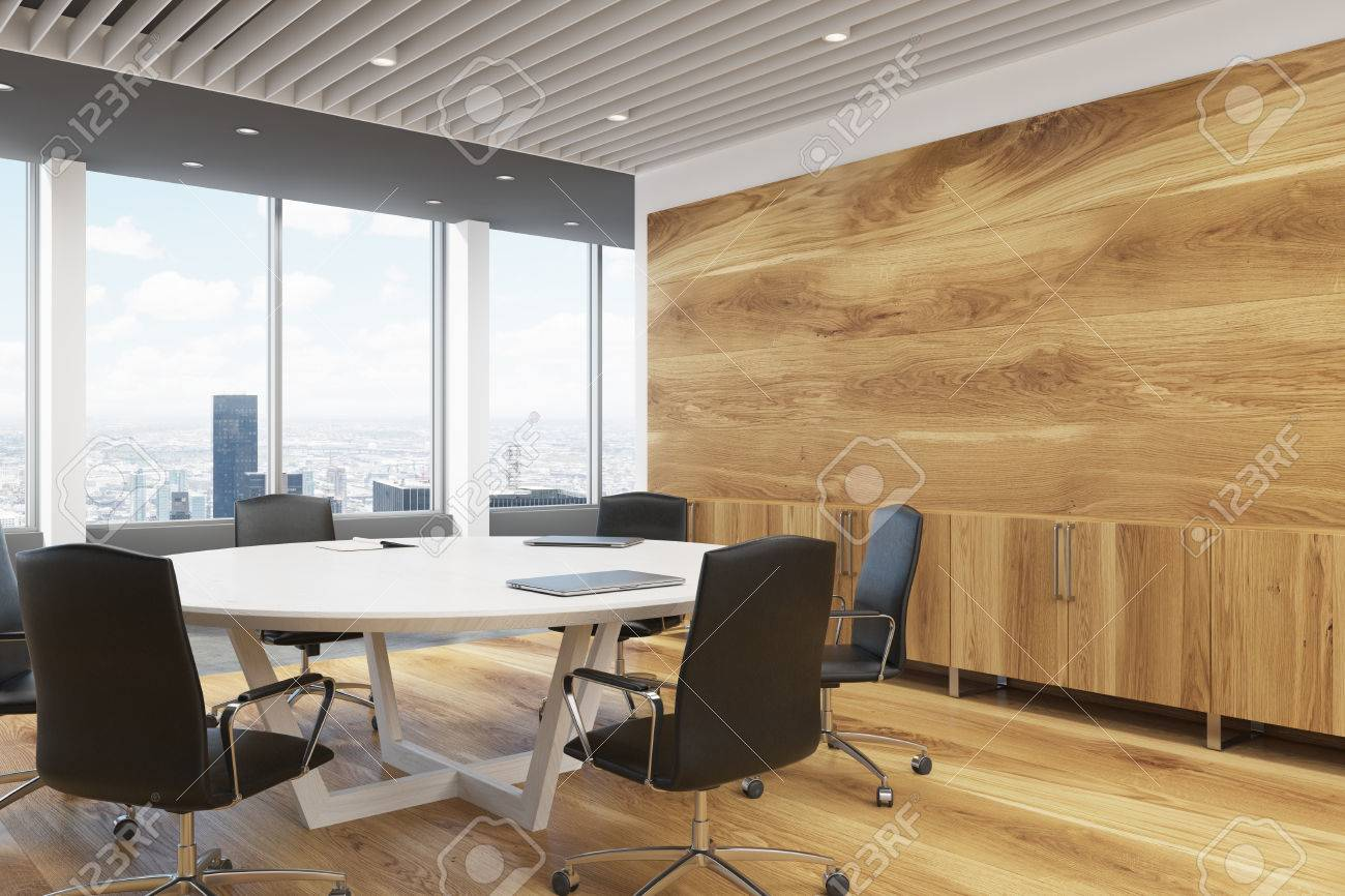 Corner Of A Dark Wooden Wall Decoration And A Large Round Meeting Room  Table. 3d