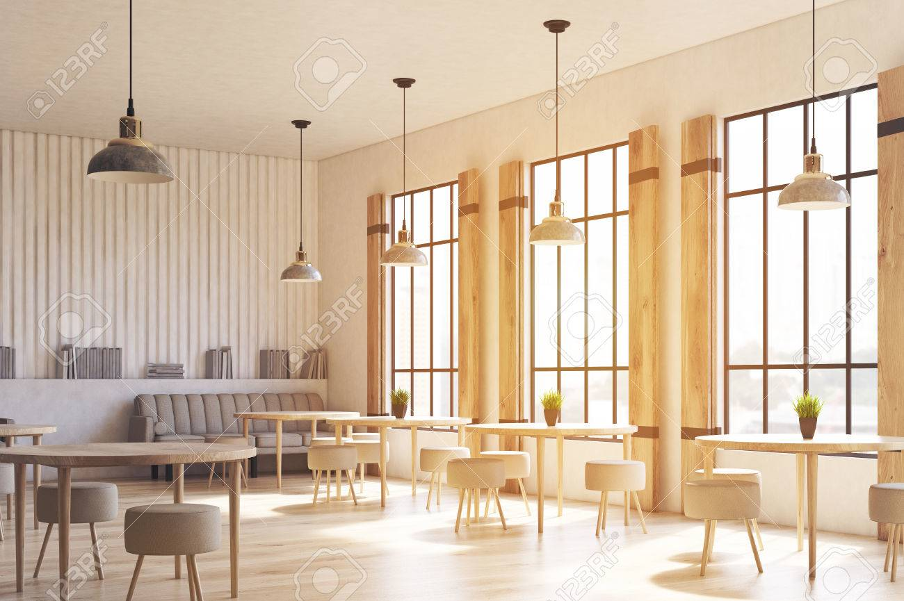 Seitenansicht eines modernen café innenraums mit betonwänden und