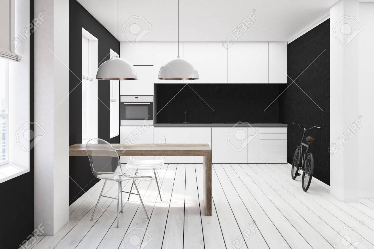 Banque Du0027images   Intérieur De Cuisine Blanc Et Noir Avec Plancher De Bois  Blanc, Table Minimaliste, Chaises Transparentes Et Comptoirs Avec Four  Encastré.