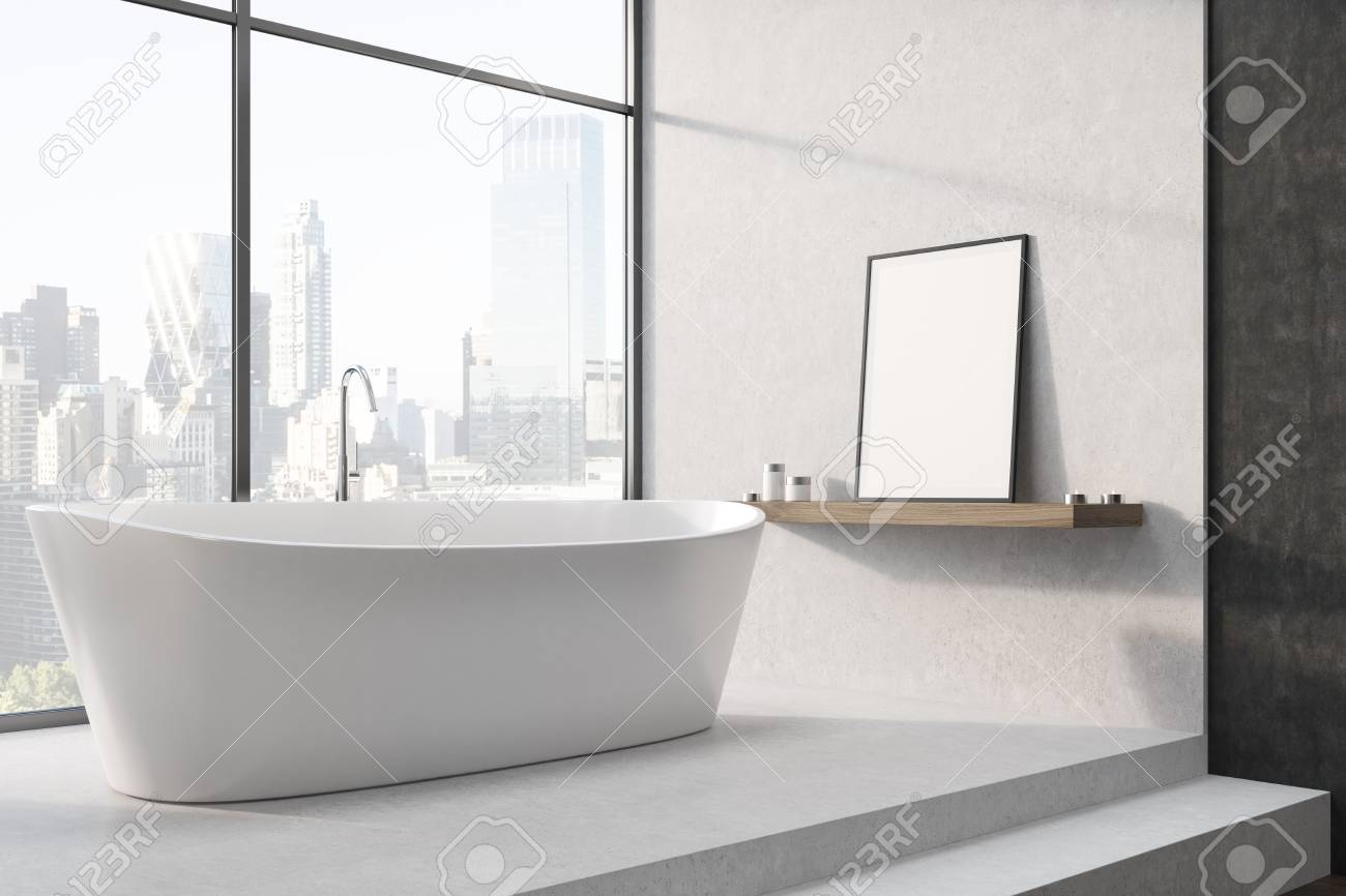 Vasca Da Bagno Enorme white bathtub is standing on stairs in a white room with a large..