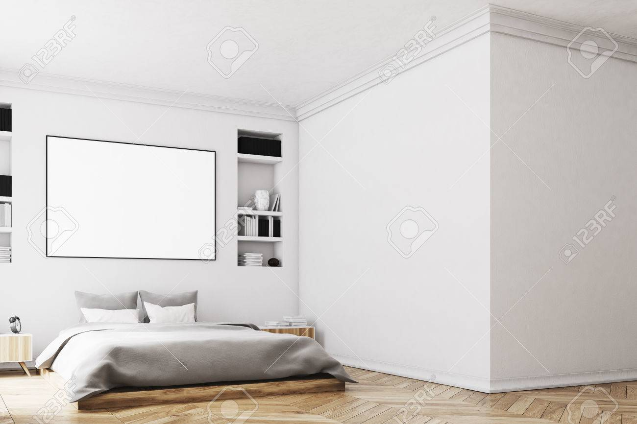 Interior of a modern luxury bedroom with white walls, a large..