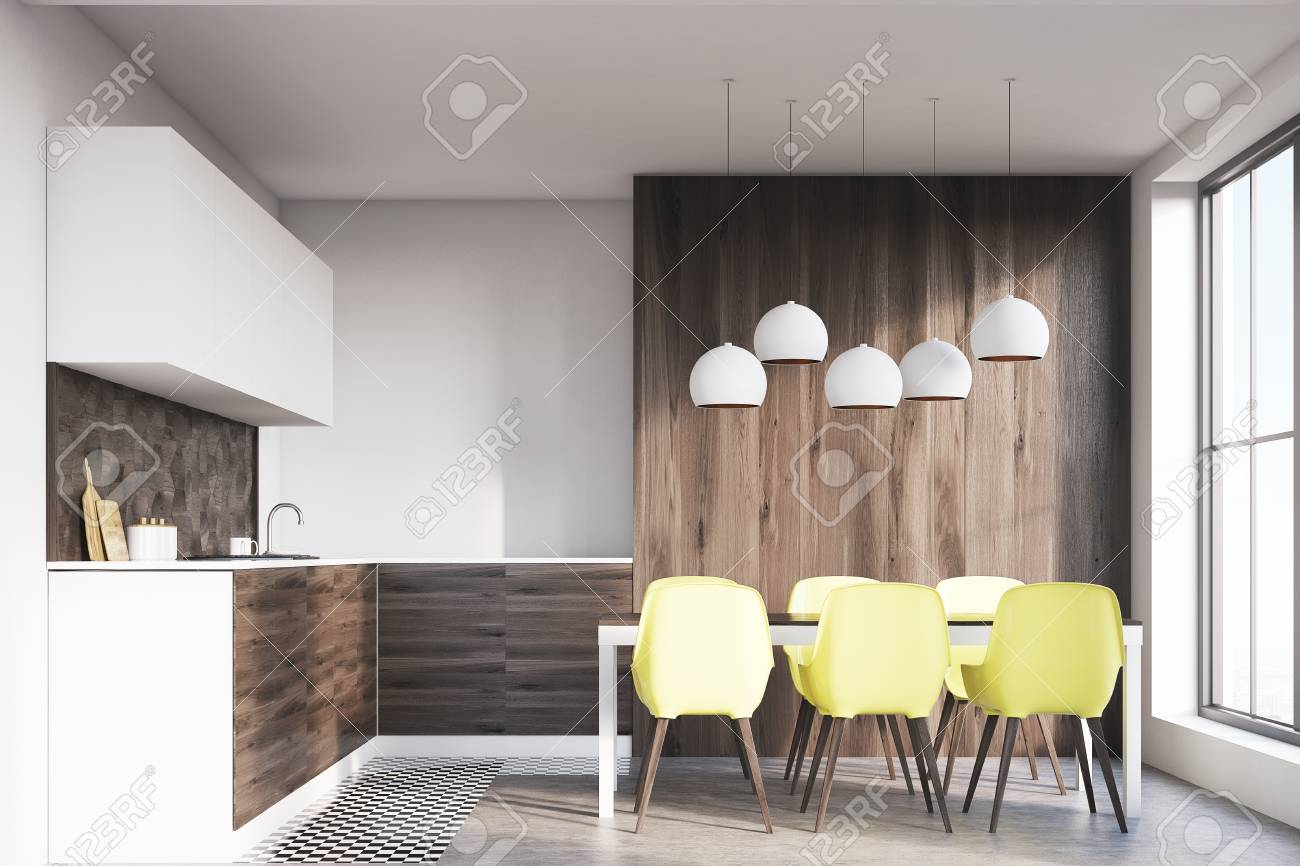 Dark wooden kitchen interior with white walls and wooden floor. Dining table with yellow chairs & Dark Wooden Kitchen Interior With White Walls And Wooden Floor ...