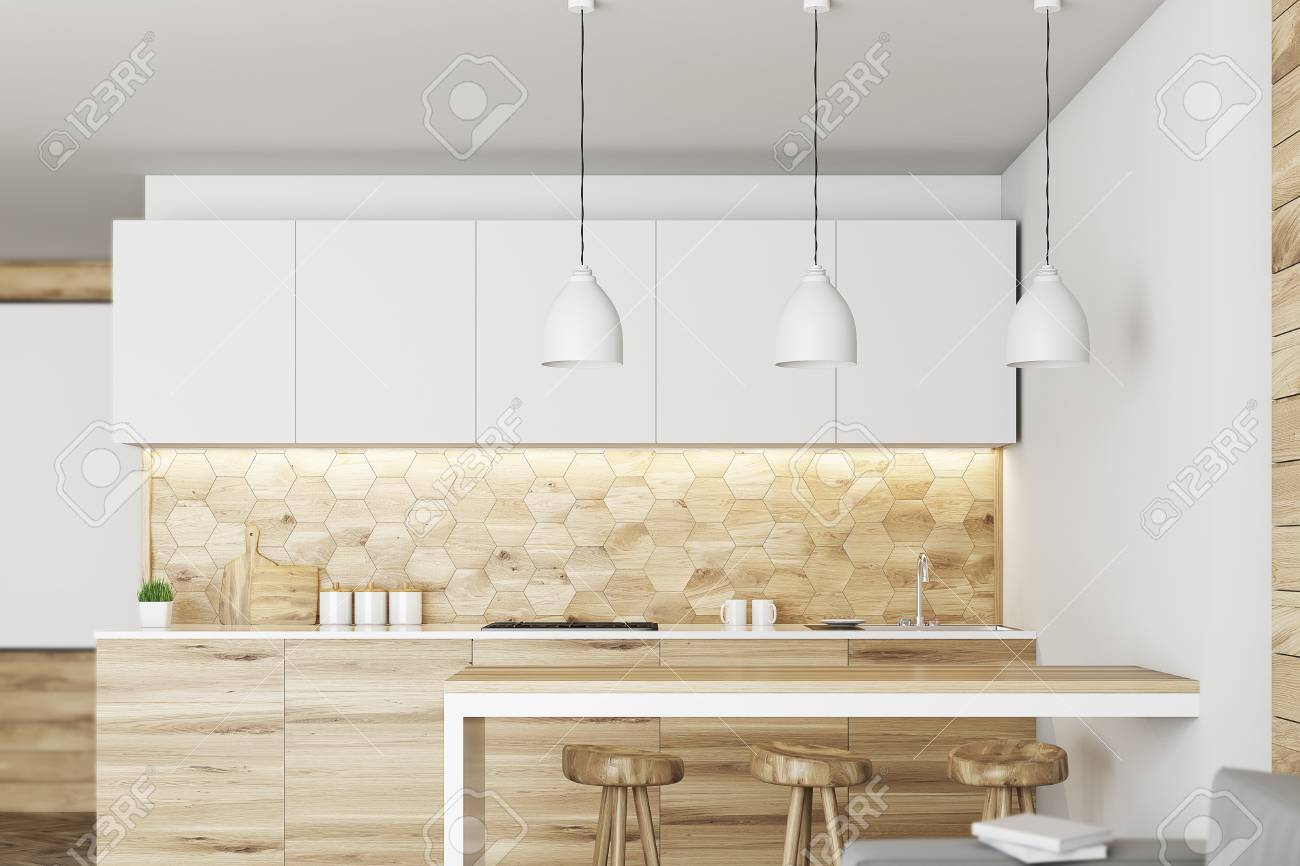 Luxury kitchen interior with white and wooden walls, countertops..