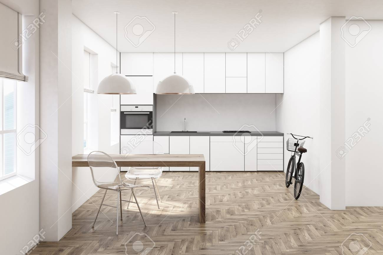 Stock Photo   White Kitchen Interior With Wooden Floor, Minimalist Table, Transparent  Chairs And Countertops With A Built In Oven. 3d Rendering Mock Up