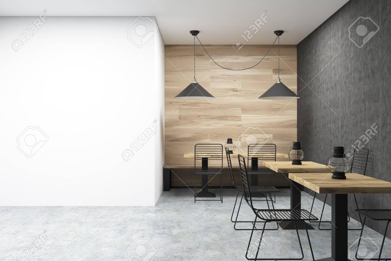 Pareti Con Foto In Bianco E Nero : Interiore della parete del caffè in legno e nero con un grande