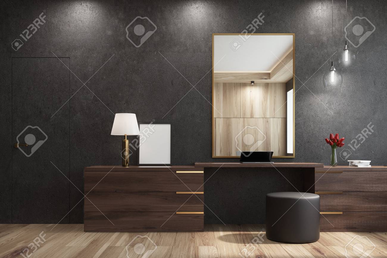 Black living room interior with a large mirror hanging above..
