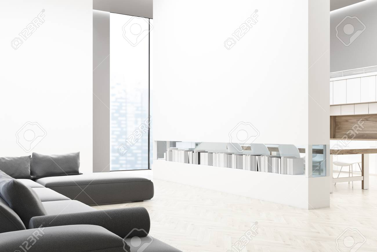 White Brick Wall Living Room With A Gray Sofa And Poufs, A Bookshelf ...