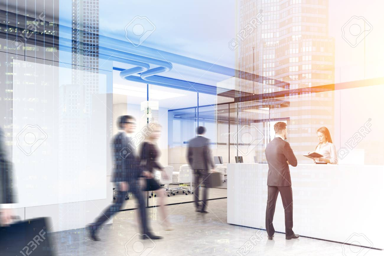 suits office. Business People In Suits Are Walking A Modern Office Lobby With Glass And White Walls
