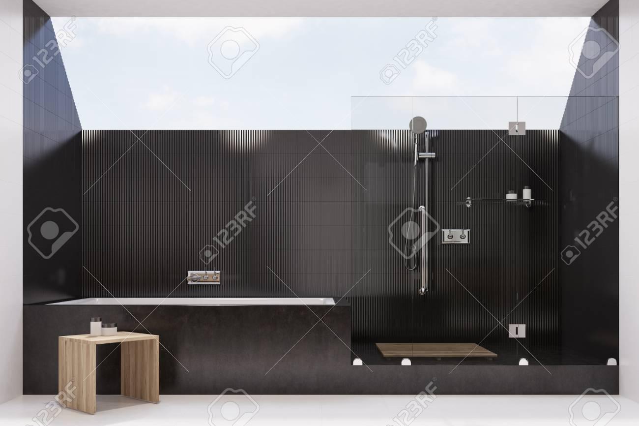 Black Tiled Bathroom Interior With A Black Marble Tub, A Shower ...