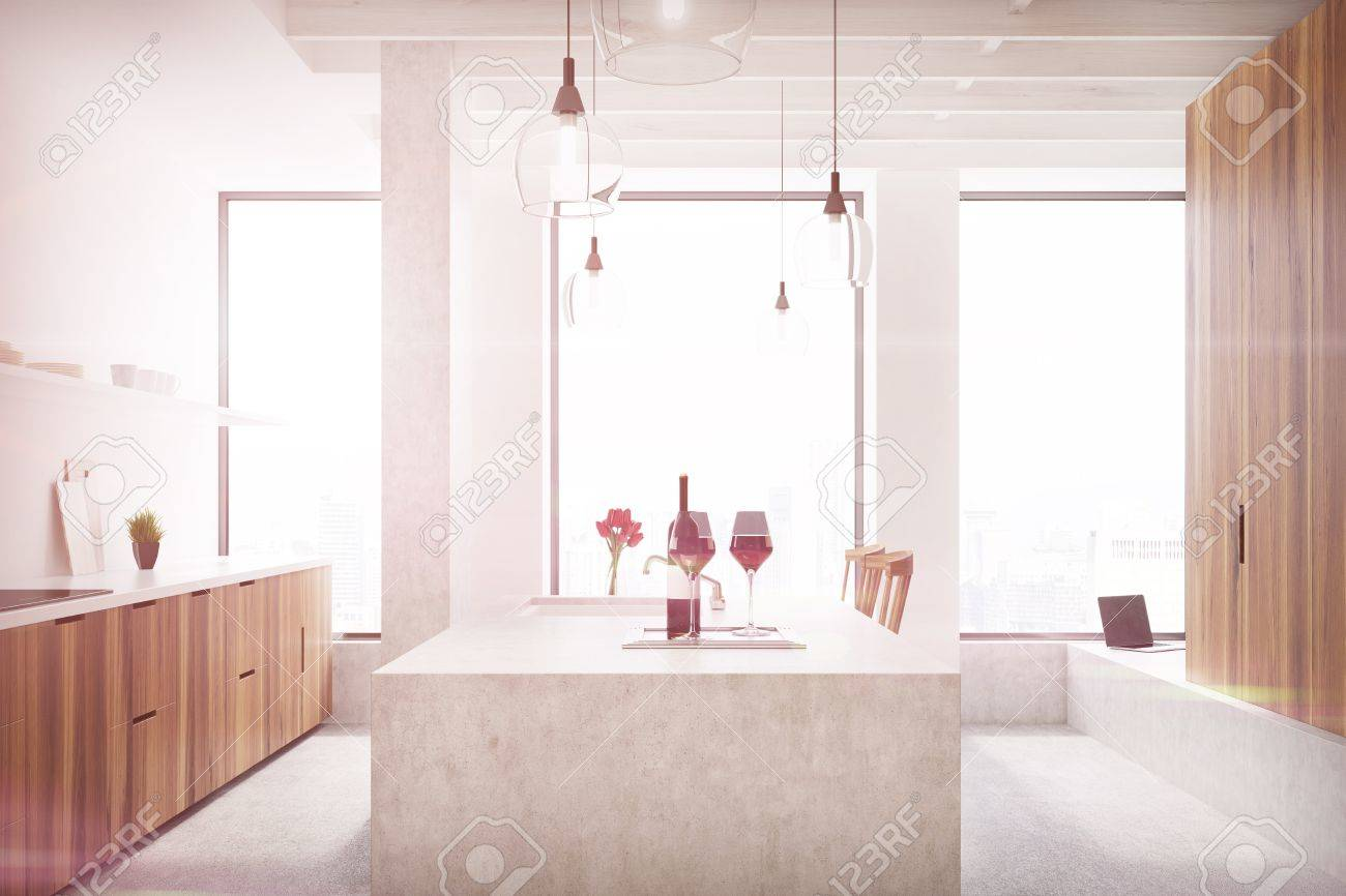 Marble Bar In A White Kitchen With Wooden Cabinets, Shelves With Glasses  And Three Tall