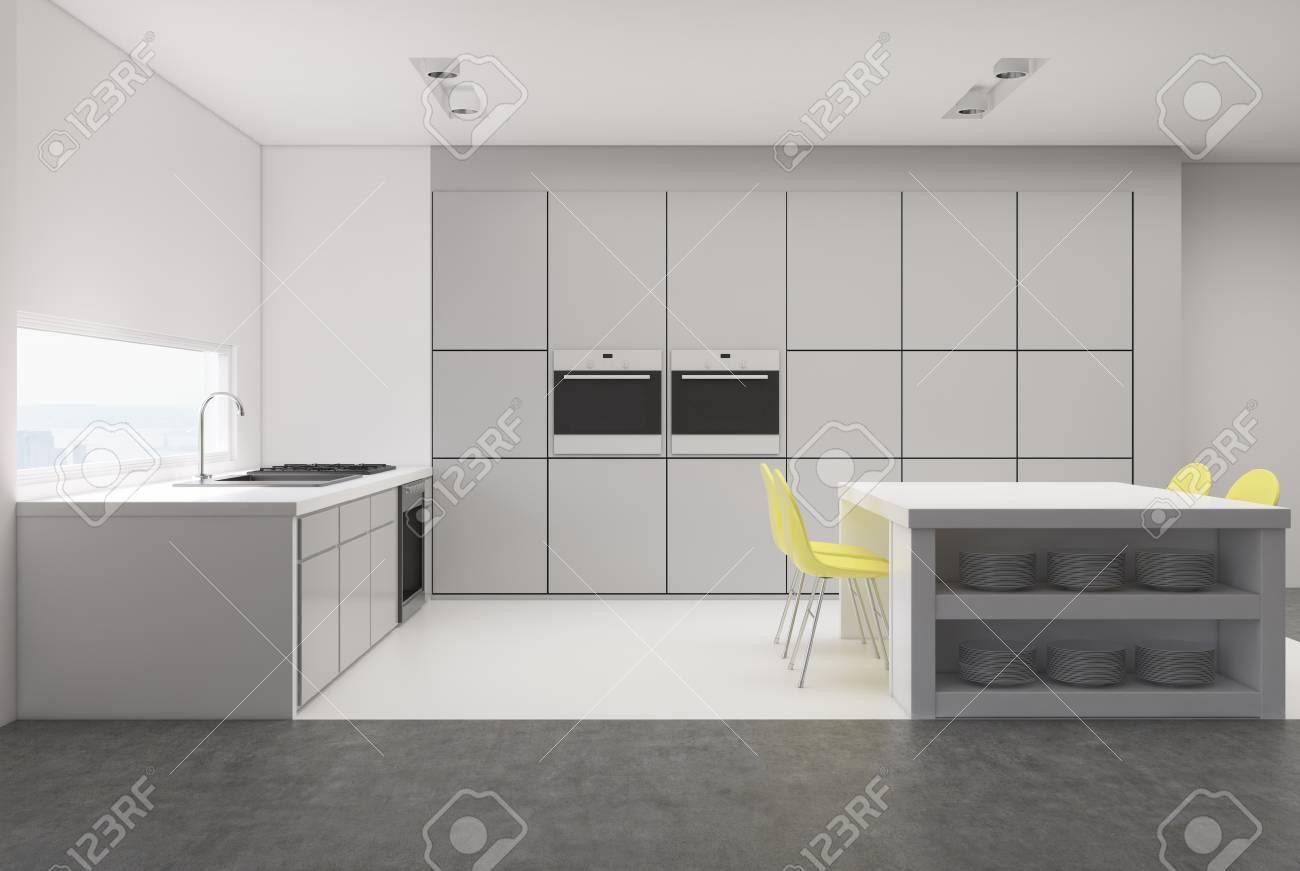interieur de cuisine grise avec une fenetre etroite une table avec des etageres integrees une rangee de comptoirs et deux fours maquette 3d