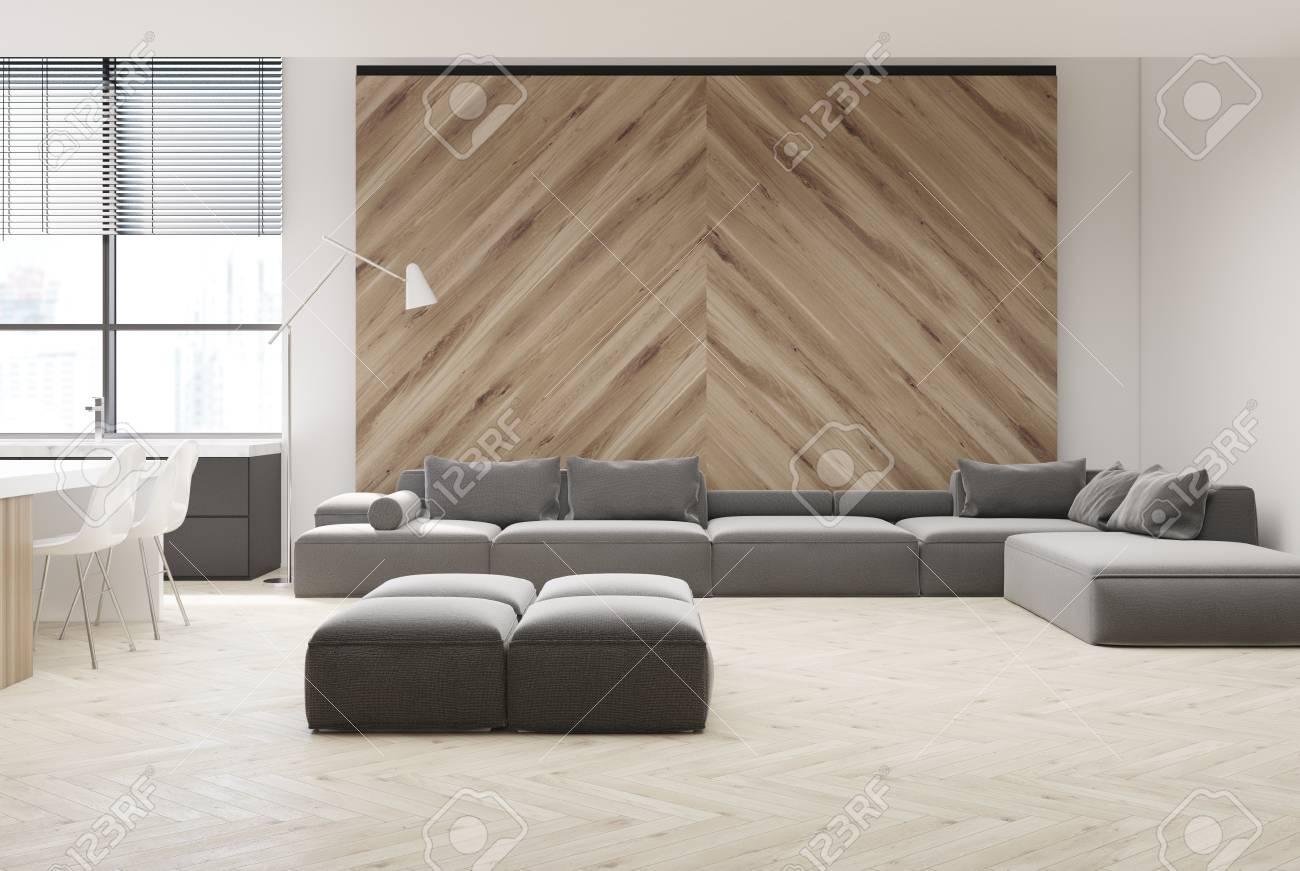 Intérieur De Salon Blanc Et En Bois Avec Un Canapé Gris, Et Une ...