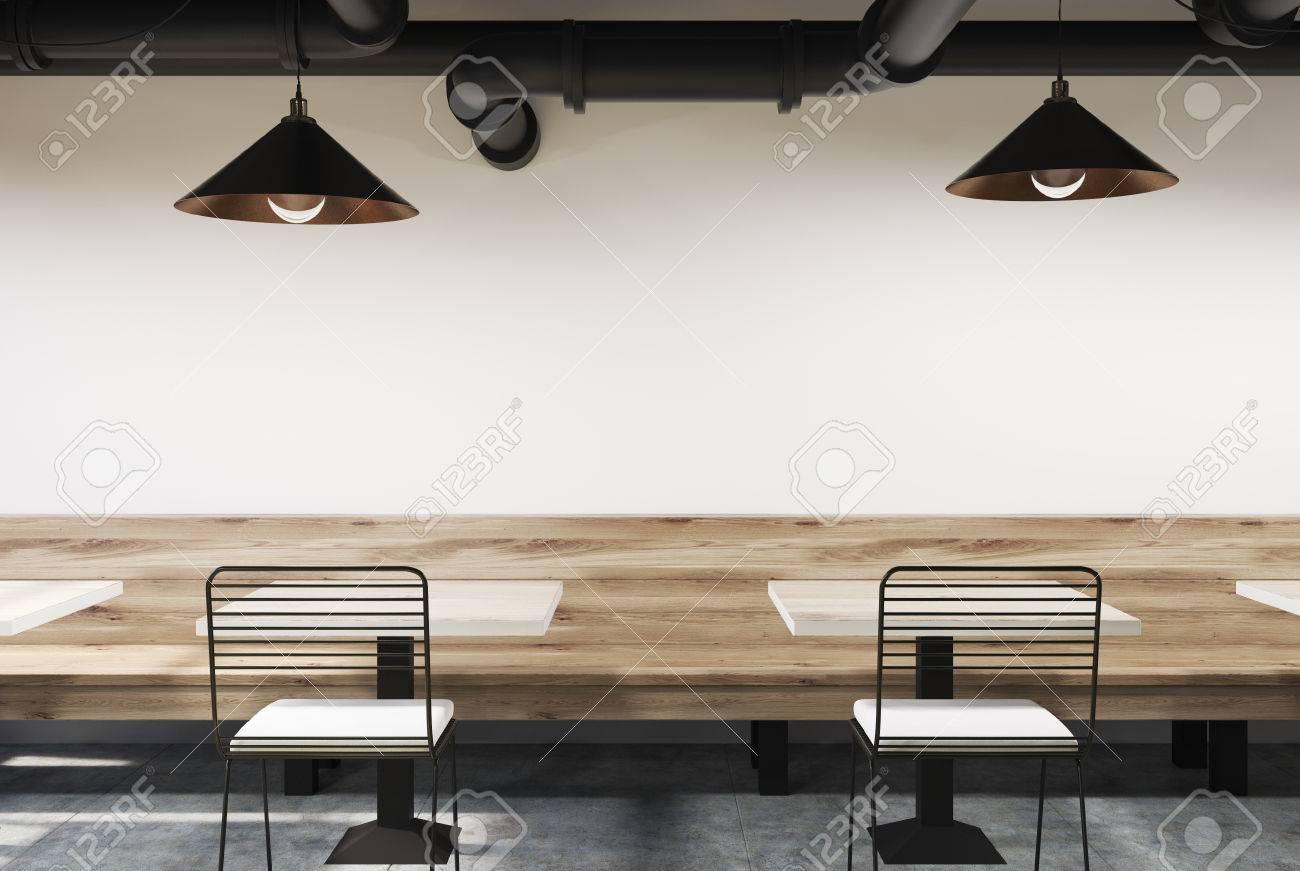Intérieur De Café Blanc Avec Un Banc En Bois Des Tables Carrées Et