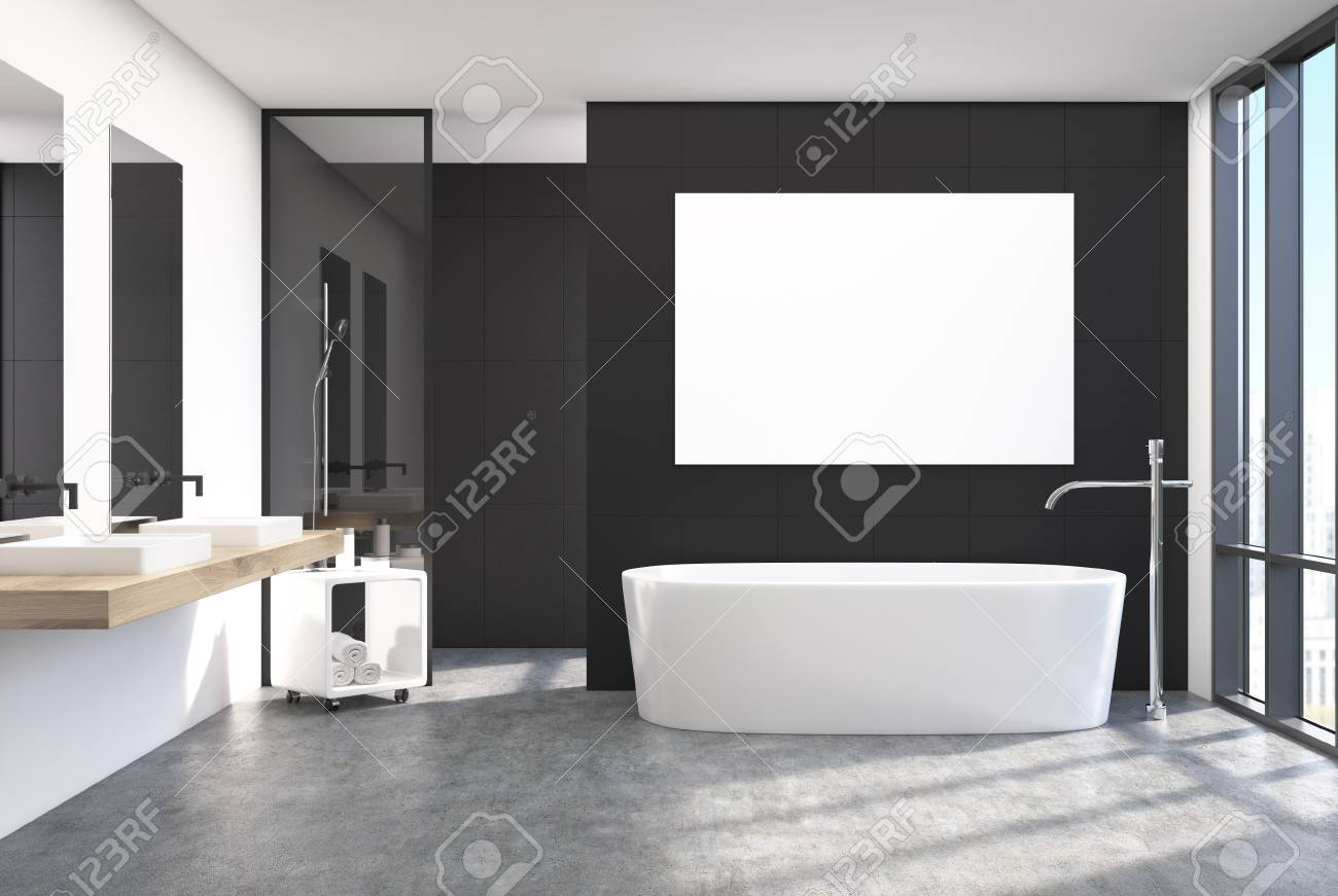Intérieur de salle de bain moderne noir avec une fenêtre loft, une affiche  horizontale suspendue au-dessus d\'une baignoire ronde, deux lavabos et ...