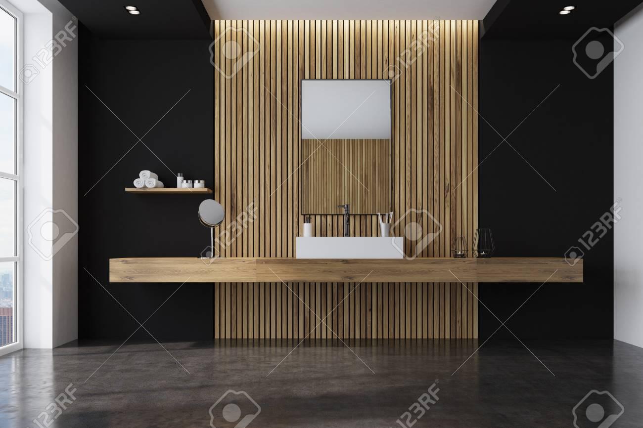 Intérieur de salle de bains noir et bois avec un lavabo angulaire sur une  étagère en bois, une lucarne et un miroir rectangulaire. Rendu 3d maquette