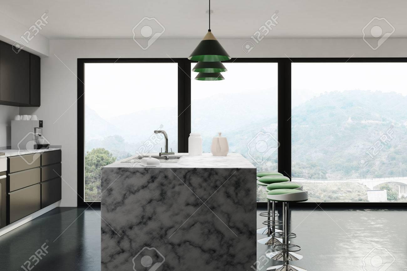 intérieur de cuisine noire avec un support de bar en marbre blanc