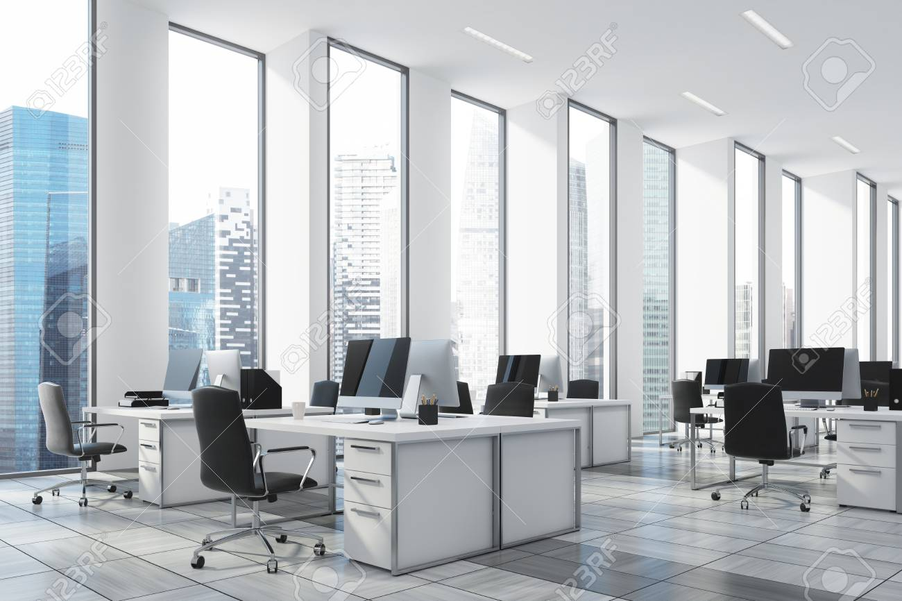 white open office with narrow tall windows white computer tables