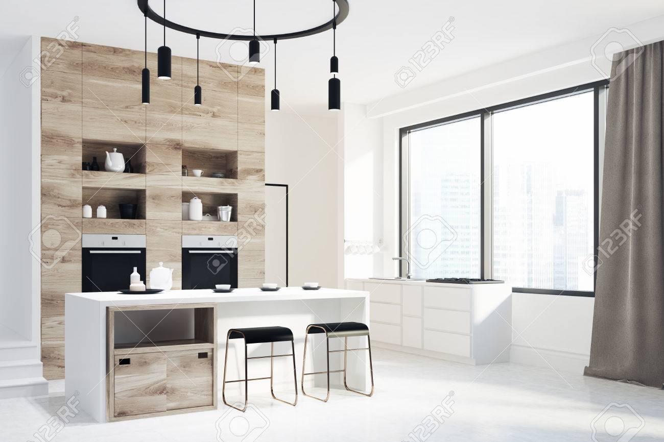 intérieur de cuisine blanc et bois avec un sol blanc, une fenêtre