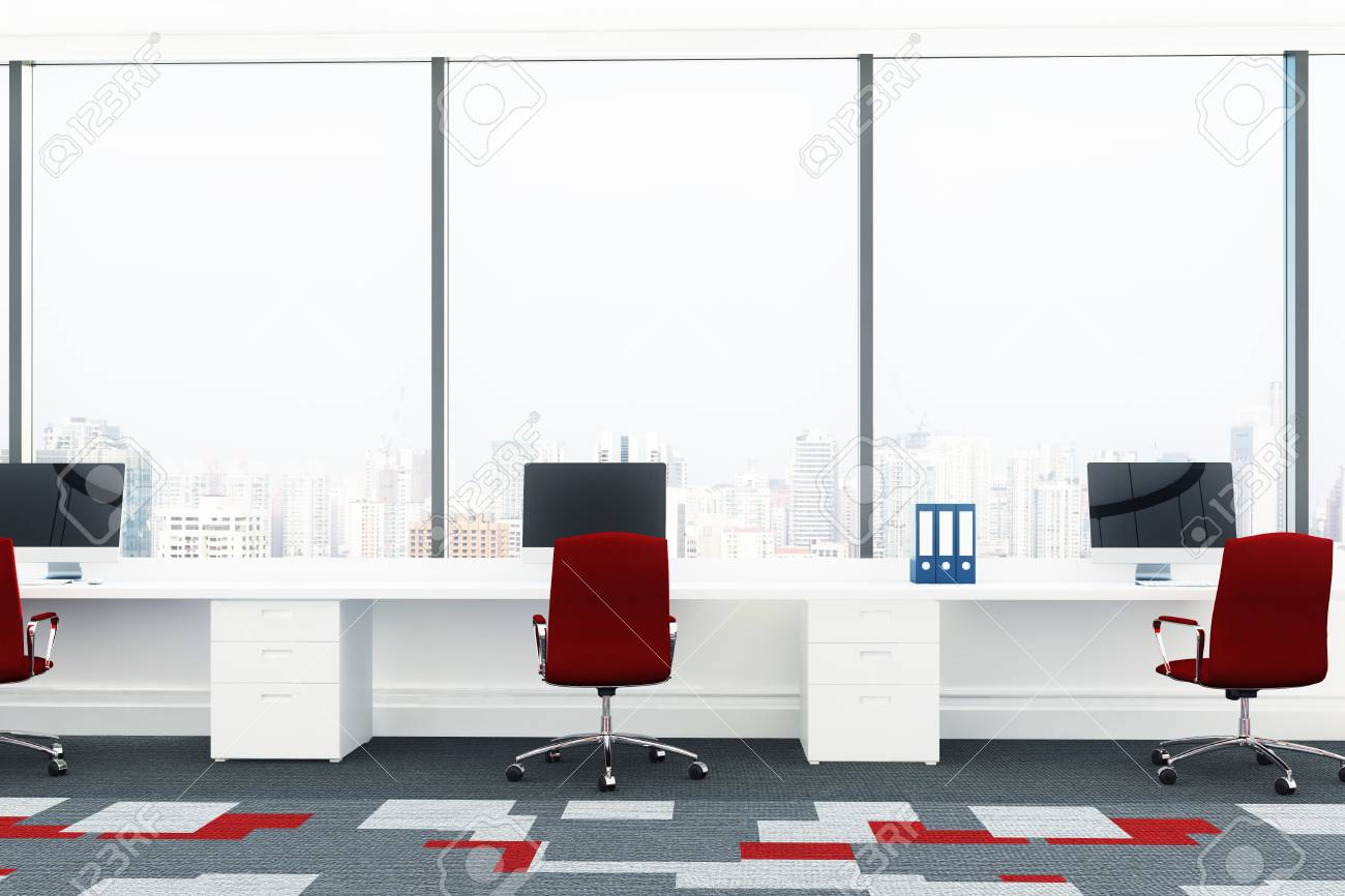 Open Office Room With White Computer Desks Red Chairs And A
