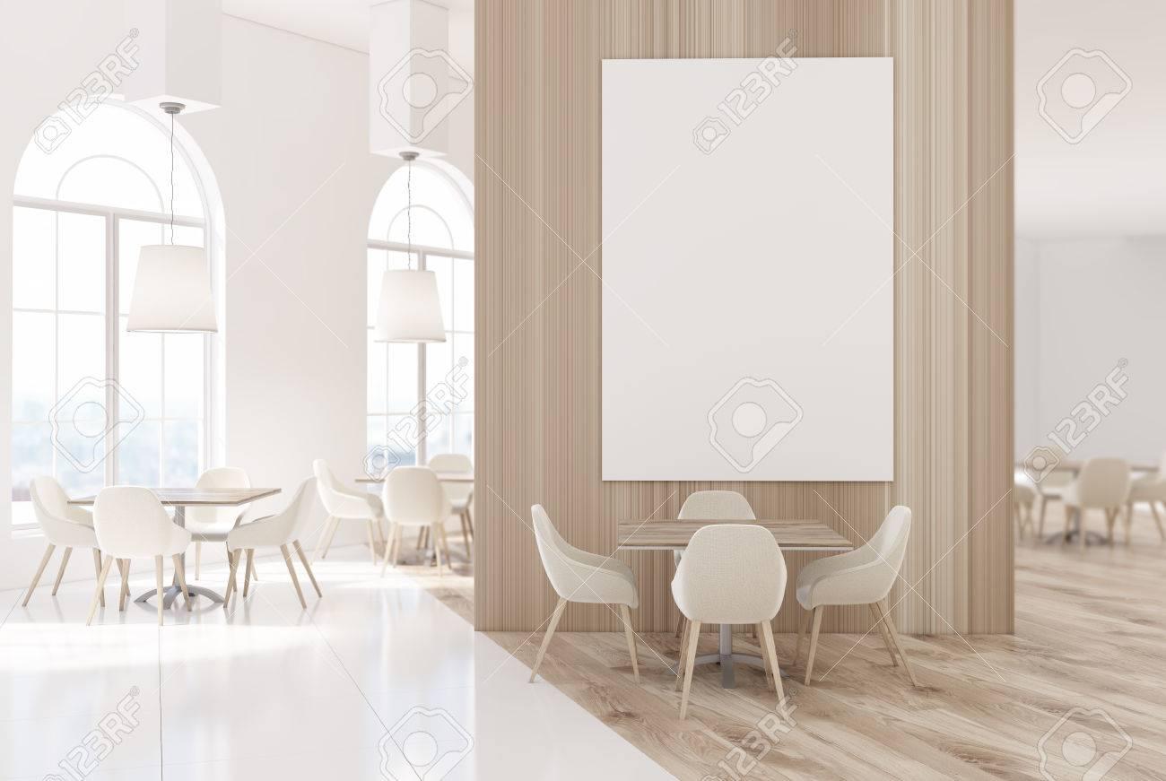 Marbre Blanc Sol Prix marbre blanc et intérieur de restaurant de luxe en bois avec un sol en  béton, de petites tables carrées avec des chaises blanches. une énorme  affiche