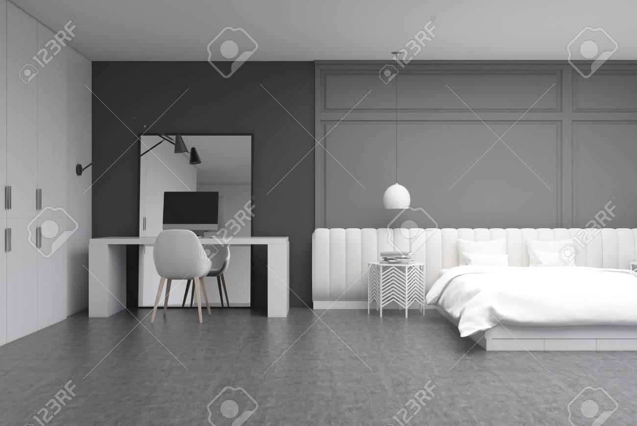 Banque Du0027images   Intérieur De Chambre à Coucher Gris Avec Un Sol En Béton,  Un Grand Lit Avec Une Couverture Blanche Et Une Table De Chevet.
