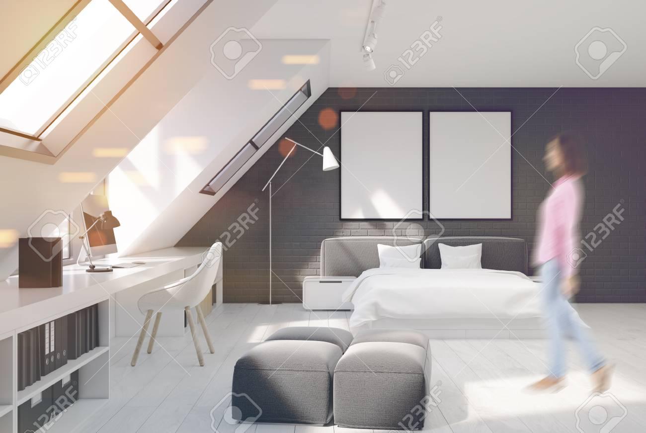 Parete Grigia Camera Da Letto camera da letto con pareti in mattoni bianchi e grigi. c'è un letto  matrimoniale bianco e grigio e una parte ufficio a casa con una scrivania  del