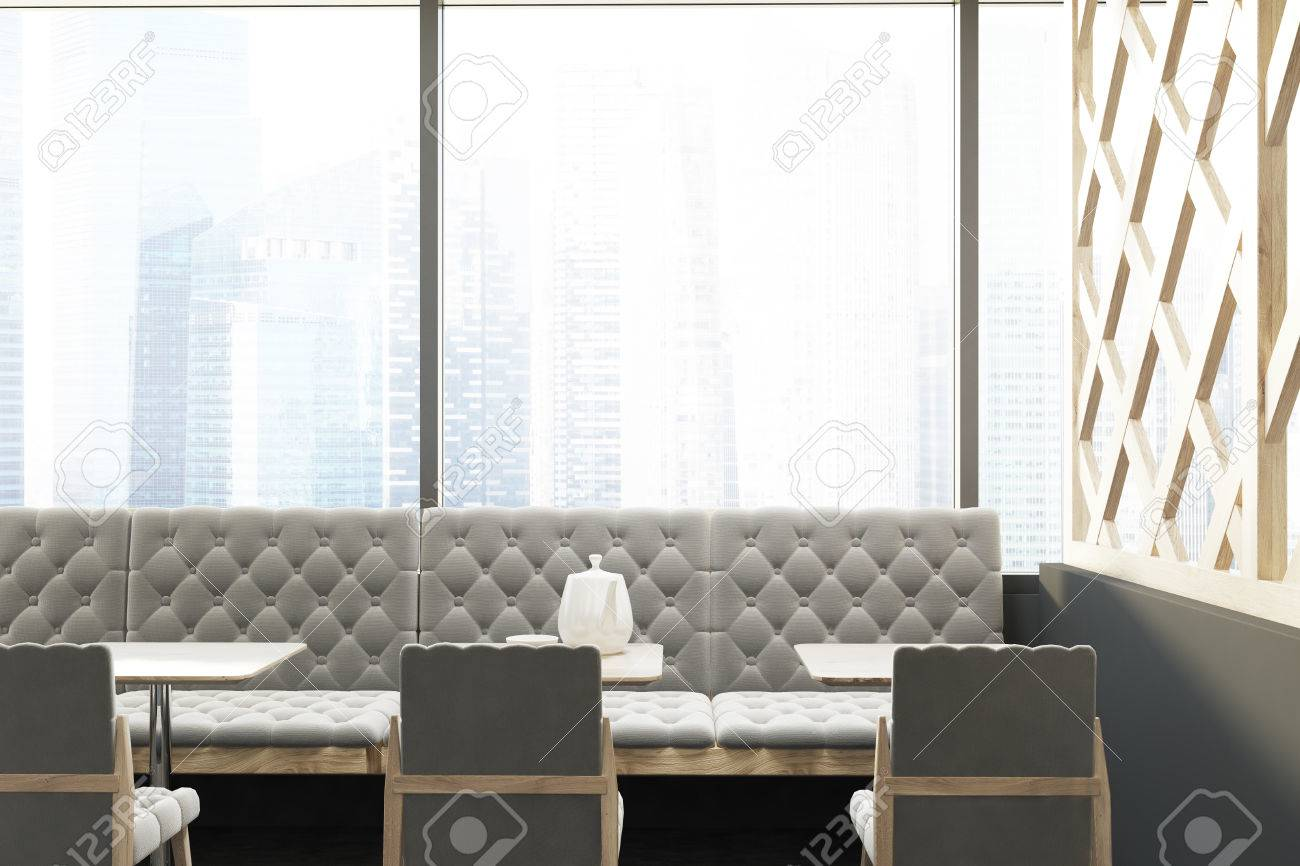 Loft Cafe Interior With A Wooden Decorative Wall Gray Armchairs