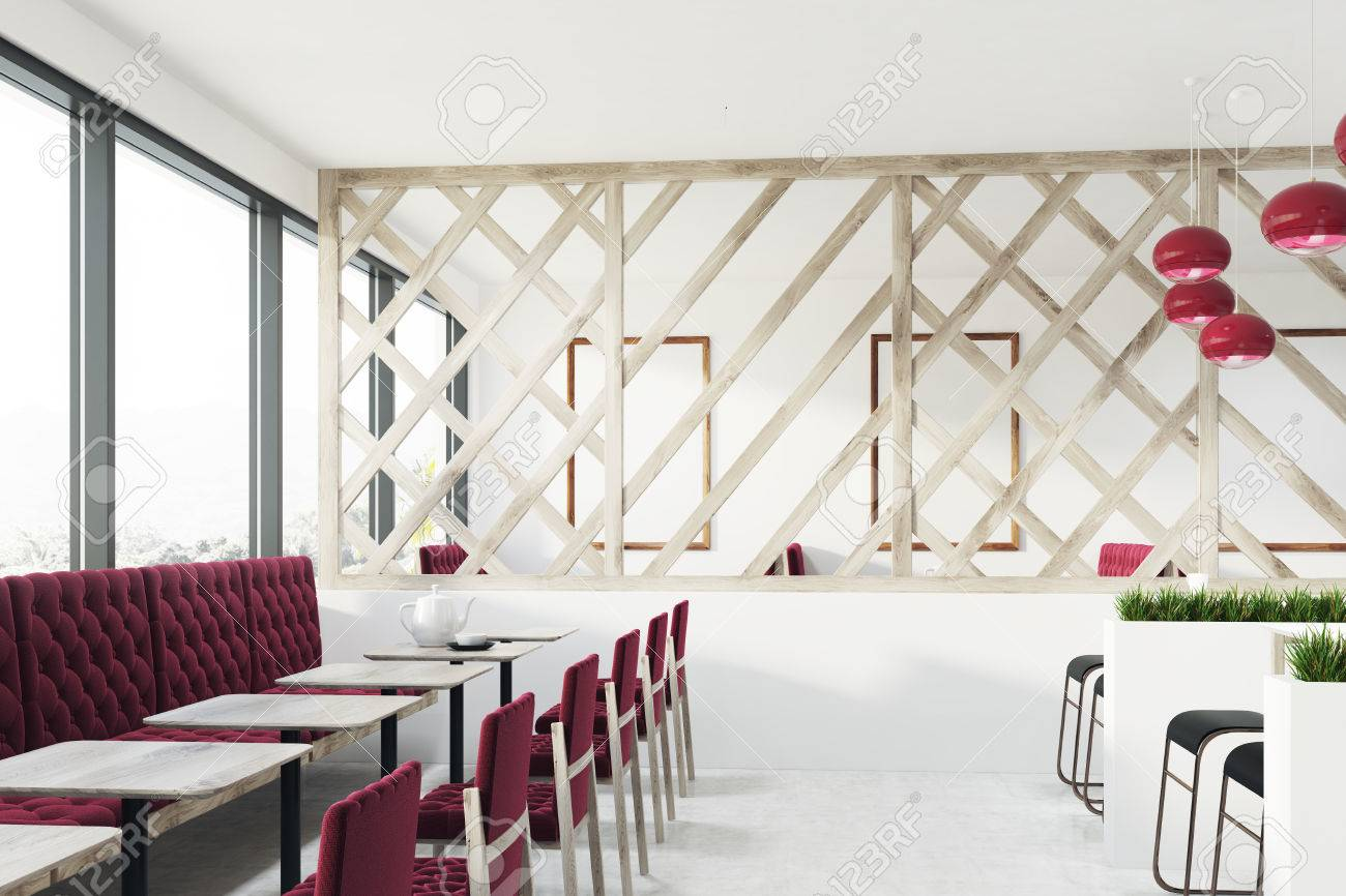 Elegant Loft Cafe Interior With A Wooden Decorative Wall, Red Armchairs And Sofas  And Small Square