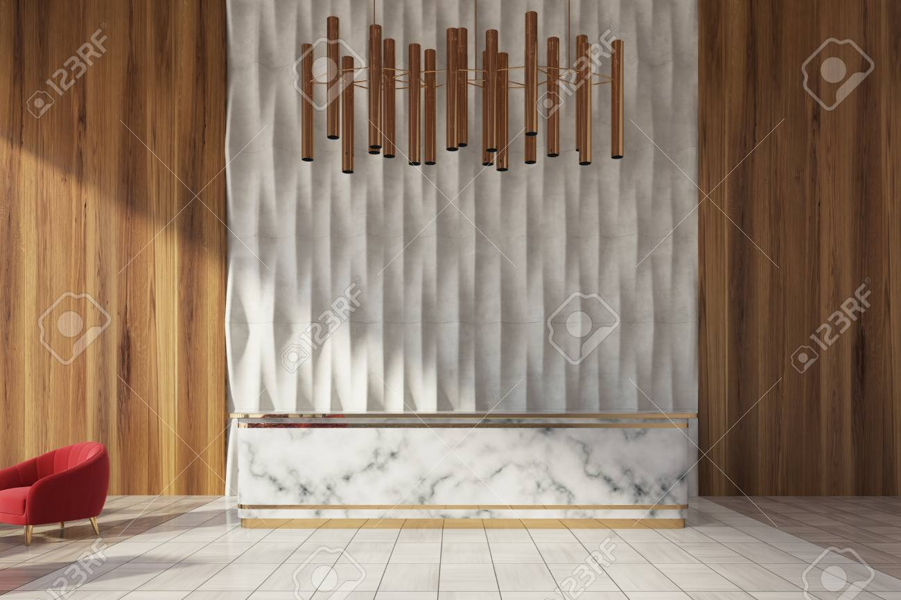wooden office. Marble Reception Desk Standing In A White And Wooden Office Lobby With Red Armchair E