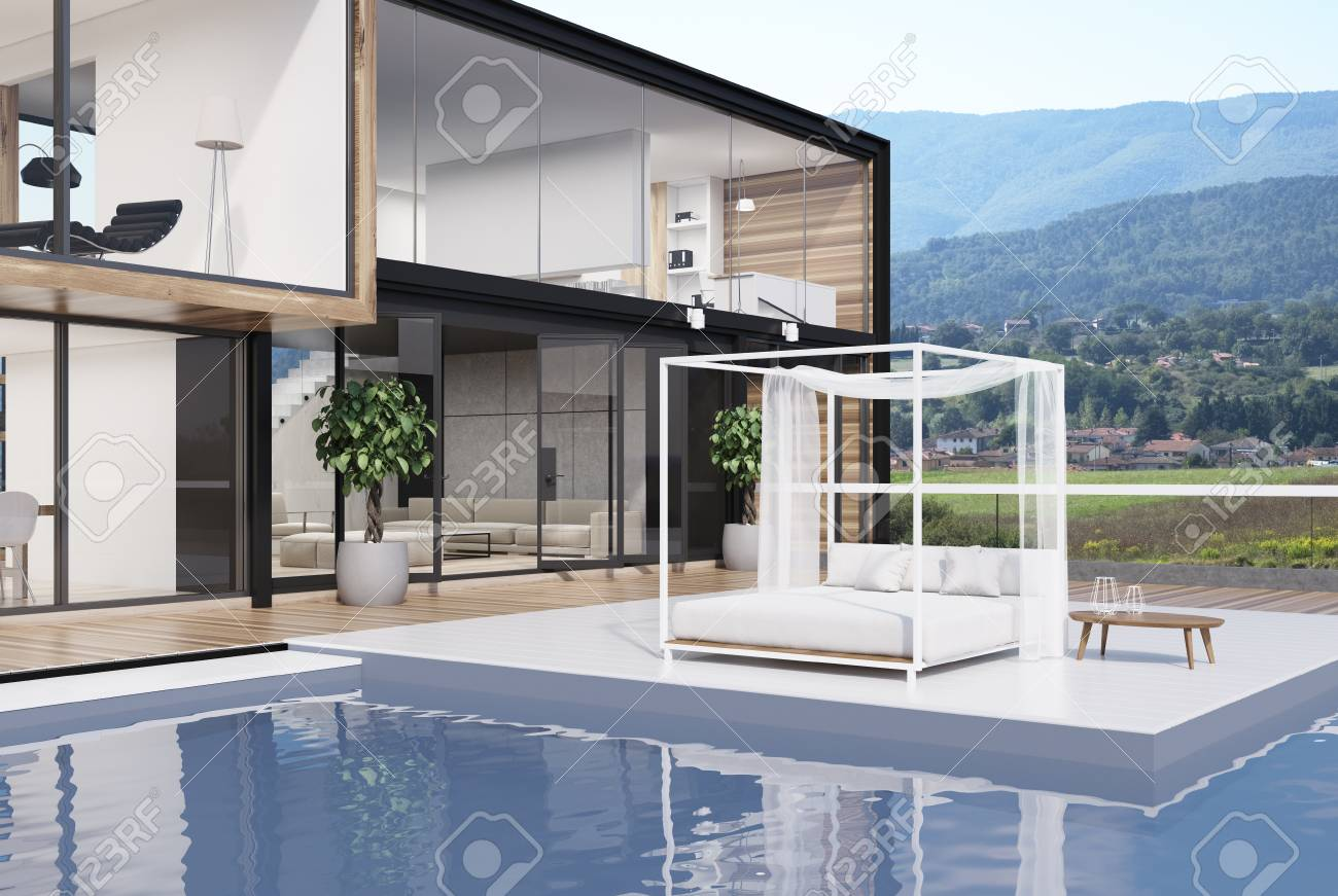 Side view of a white wooden and glass wall mansion with a luxury..