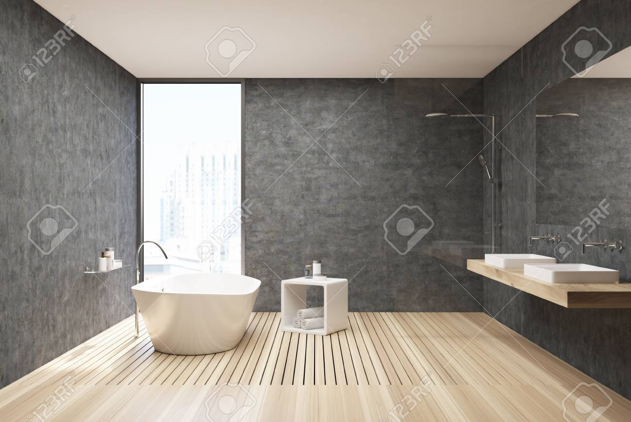 Concrete bathroom interior with concrete walls a wooden floor a white tub and a
