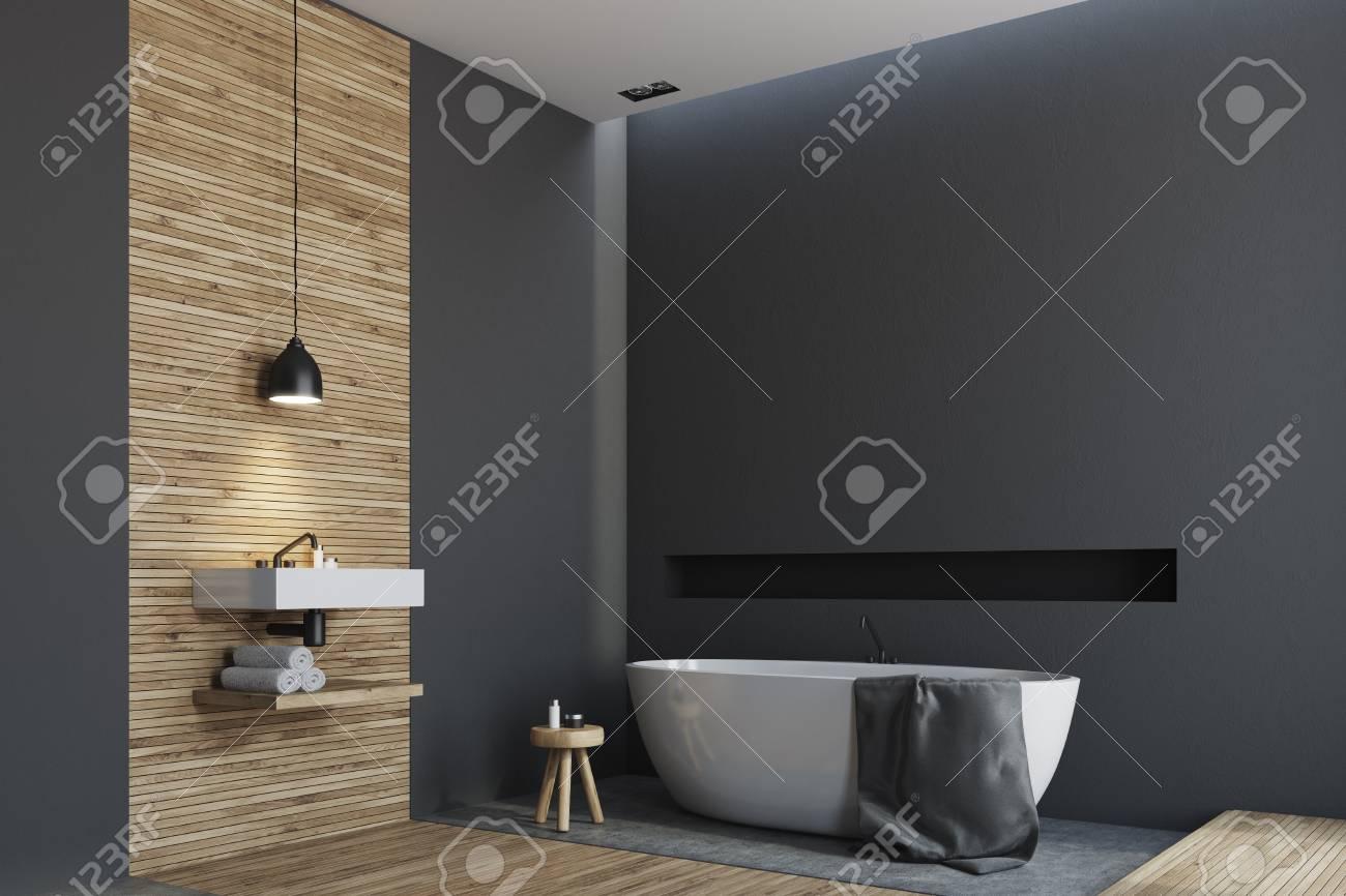 Intérieur de salle de bain noir et bois avec un plancher en bois, une  baignoire ronde blanche et un évier angulaire. Vue de côté. Maquette 3D