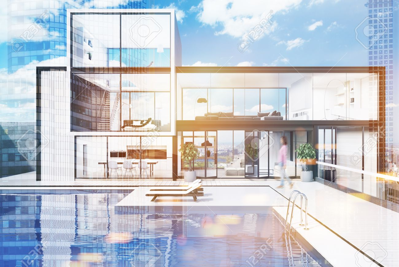 White wooden and glass wall mansion with a luxury swimming pool...
