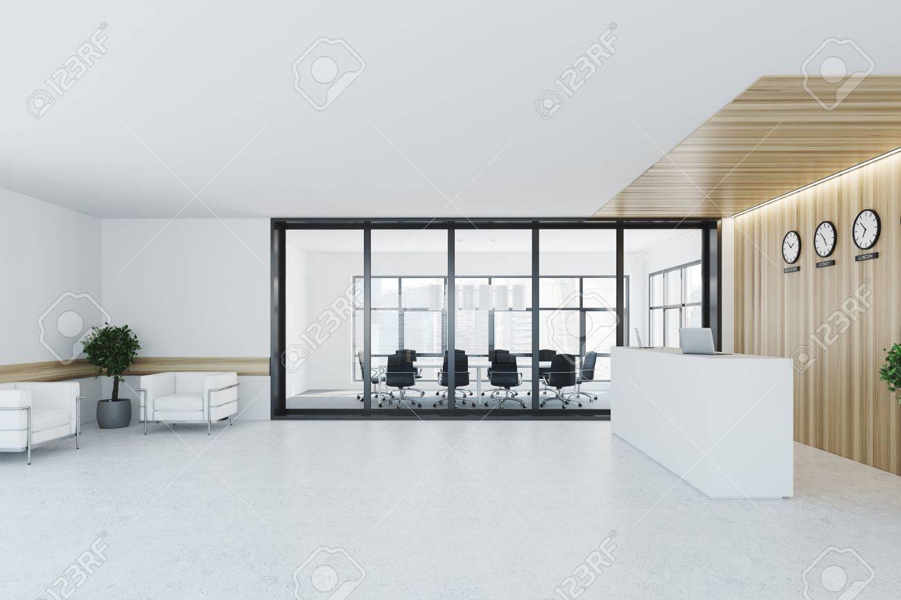 Intérieur de bureau blanc et bois avec un sol en béton deux