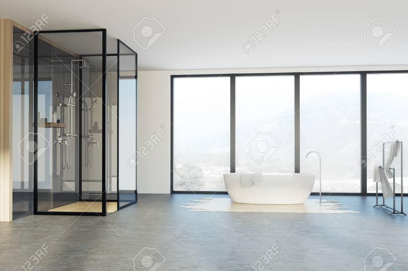 Loft Bathroom Interior With A Shower, A White Tub, A Towel Rack ...