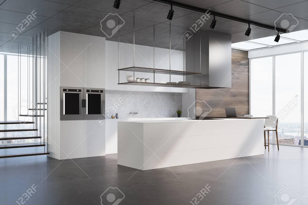 Escalier Interieur Beton Design intérieur de cuisine blanc et en bois avec comptoir blanc, dosseret en  béton, escalier futuriste et sol en béton. vue de côté. rendu 3d maquette