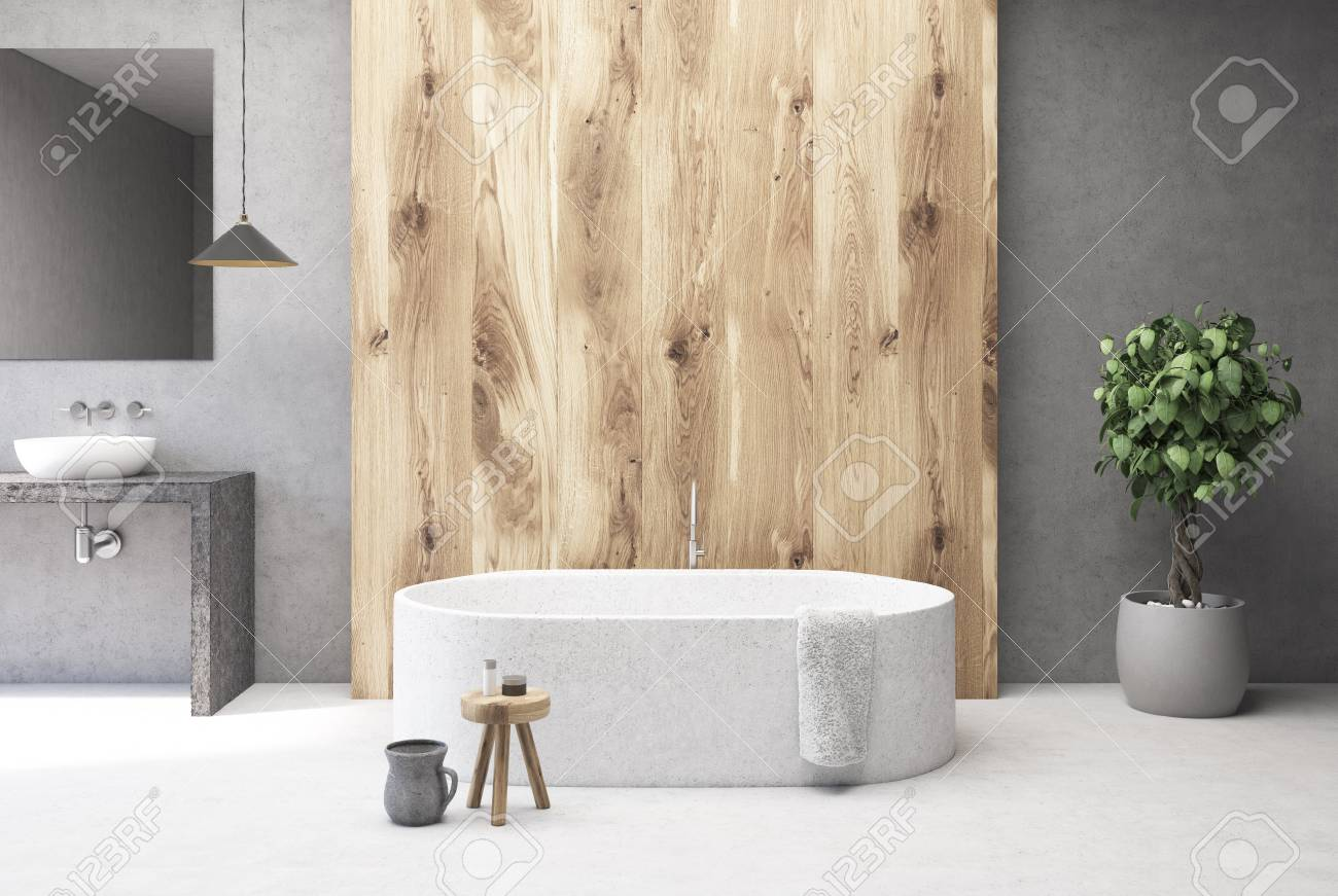 Close Up Of A White Marble Bath Tub Standing In Concrete And Wooden Bathroom With