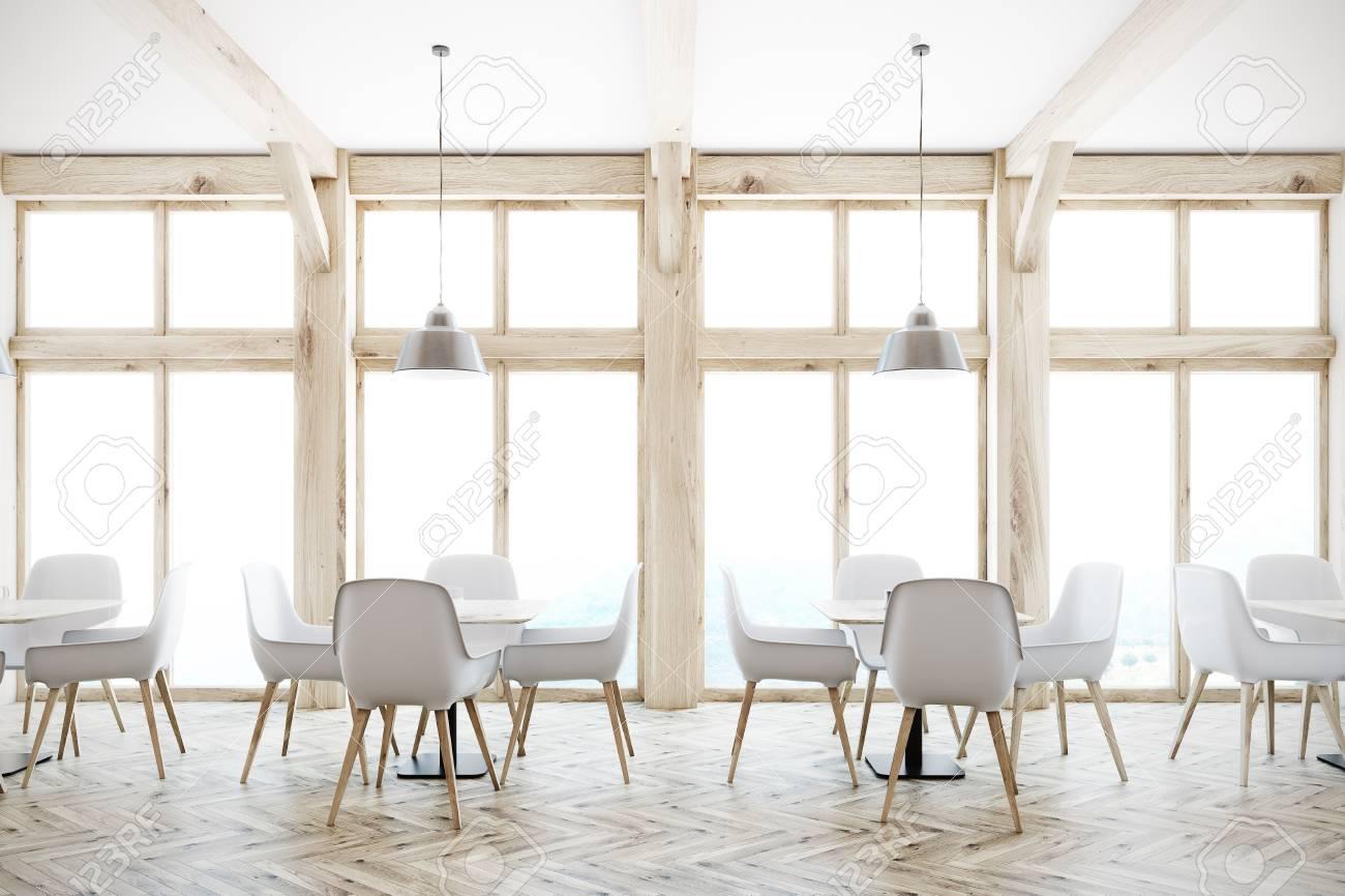 https://previews.123rf.com/images/ismagilov/ismagilov1710/ismagilov171000177/87744896-interno-bianco-del-caff%C3%A8-con-alte-finestre-un-pavimento-in-legno-tavoli-quadrati-e-sedie-bianche-e-di-.jpg