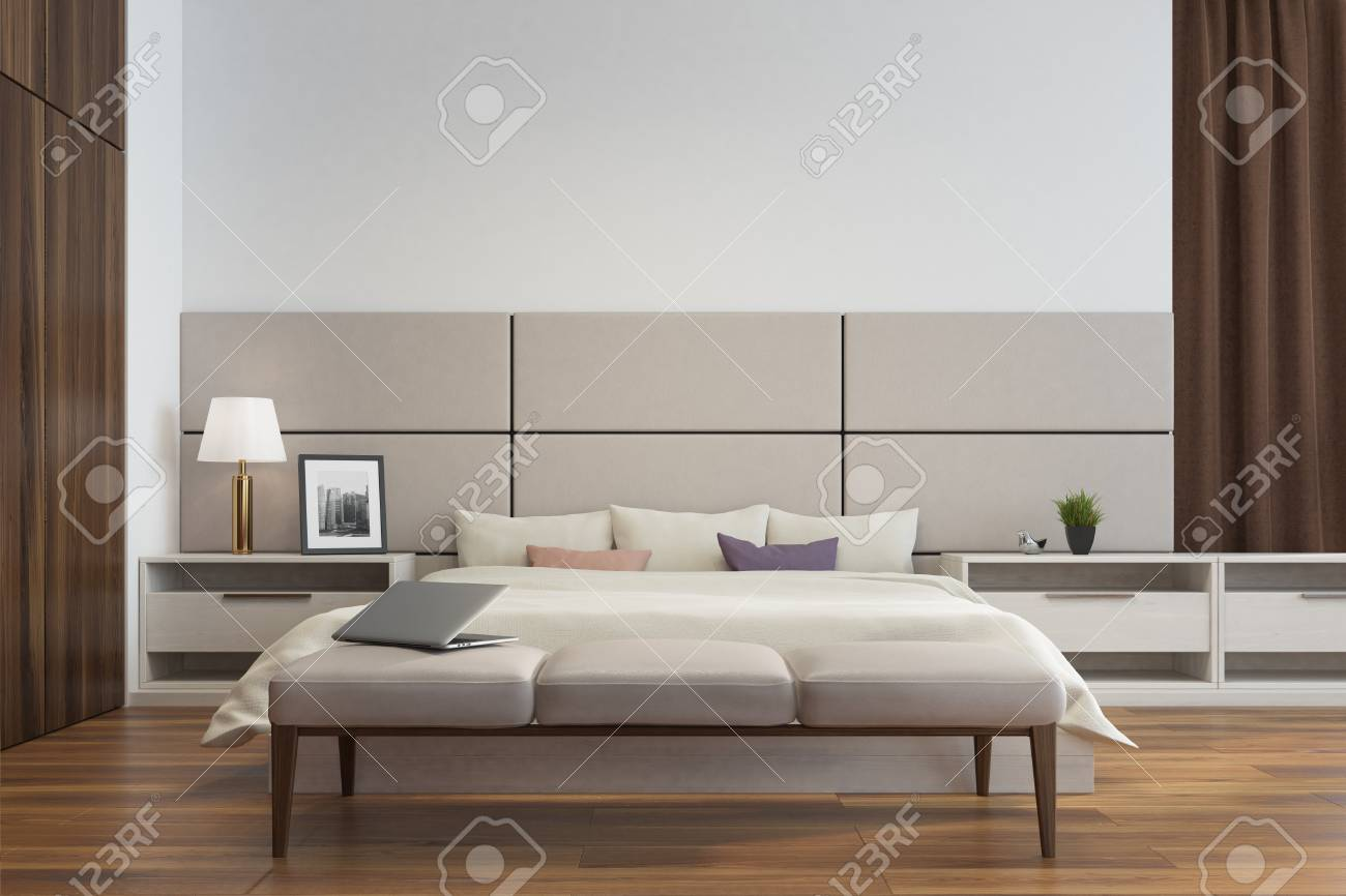 White and beige bedroom interior close up with a double bed,..