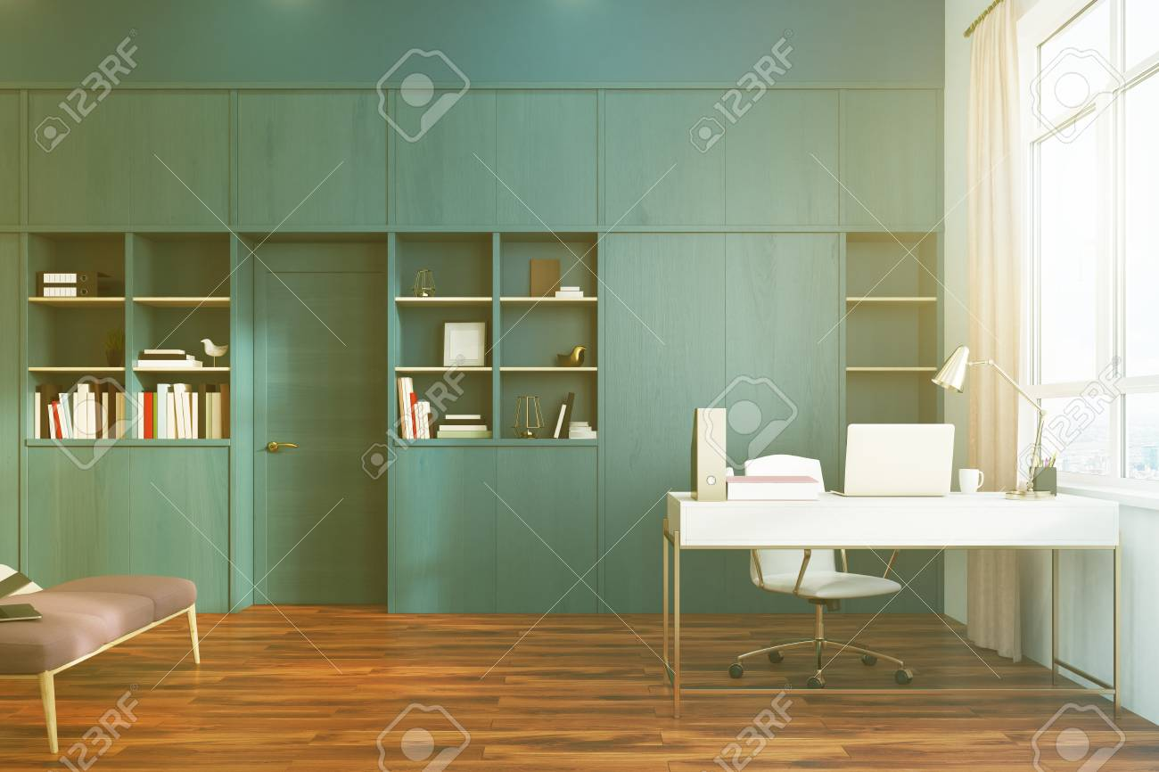 White bedroom interior with a double bed, a computer desk, an..