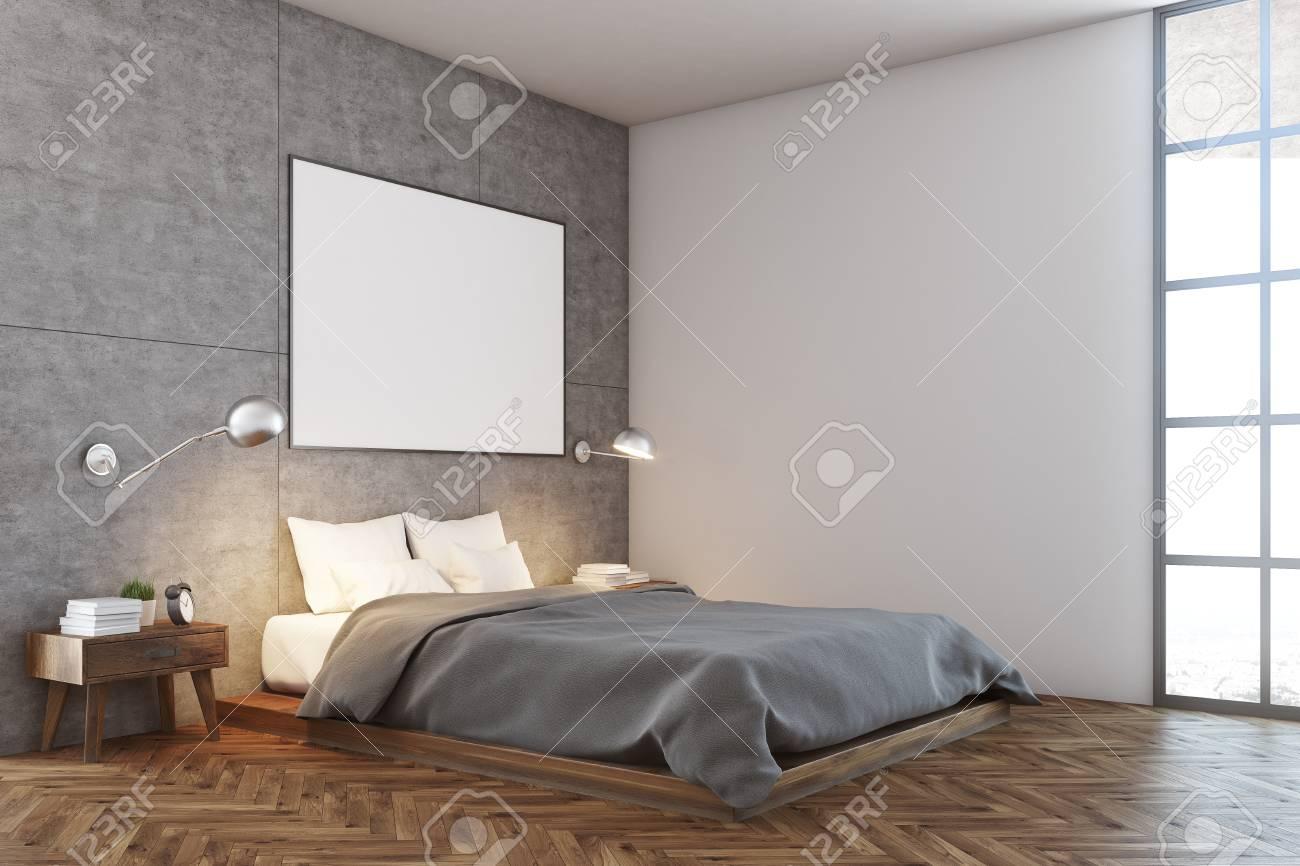 coin chambre de luxe avec une fenêtre loft, murs en béton et blanc