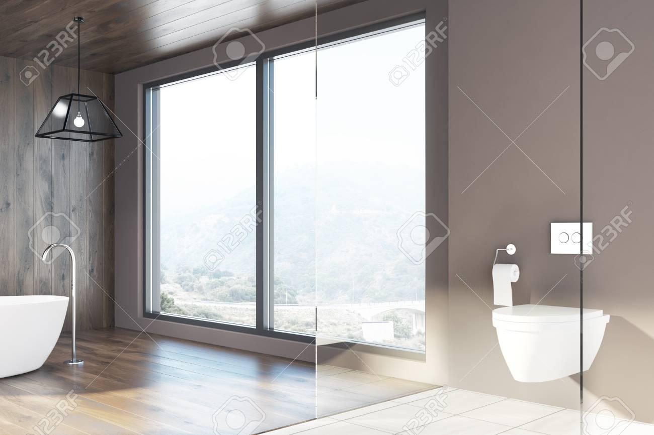 Intérieur de salle de bain moderne avec un plancher blanc et en bois, une  baignoire ronde blanche et une toilette. Fenêtres loft. Maquette 3D